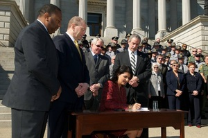 Gov. Haley signs Blue Alert Bill into law – Looking on with me is DPS Director Smith, Rep. Dennis Moss-Cherokee County and Chief Mark Keel of SLED